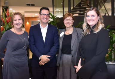 Photo of Sue Levy, Chief Executive Officer, The Honourable Zed Seselja, Assistant Minister for Science, Jobs and Innovation, Ms Rachel Stephen-Smith, Minister for Community Services and Social Inclusion and Liesel Wett, Chair of the Board of Directors celebrating the significant milestone